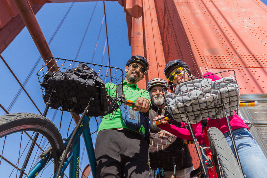 3 cyclists and their bikes on the Golden Gate Bridge, San Francisco